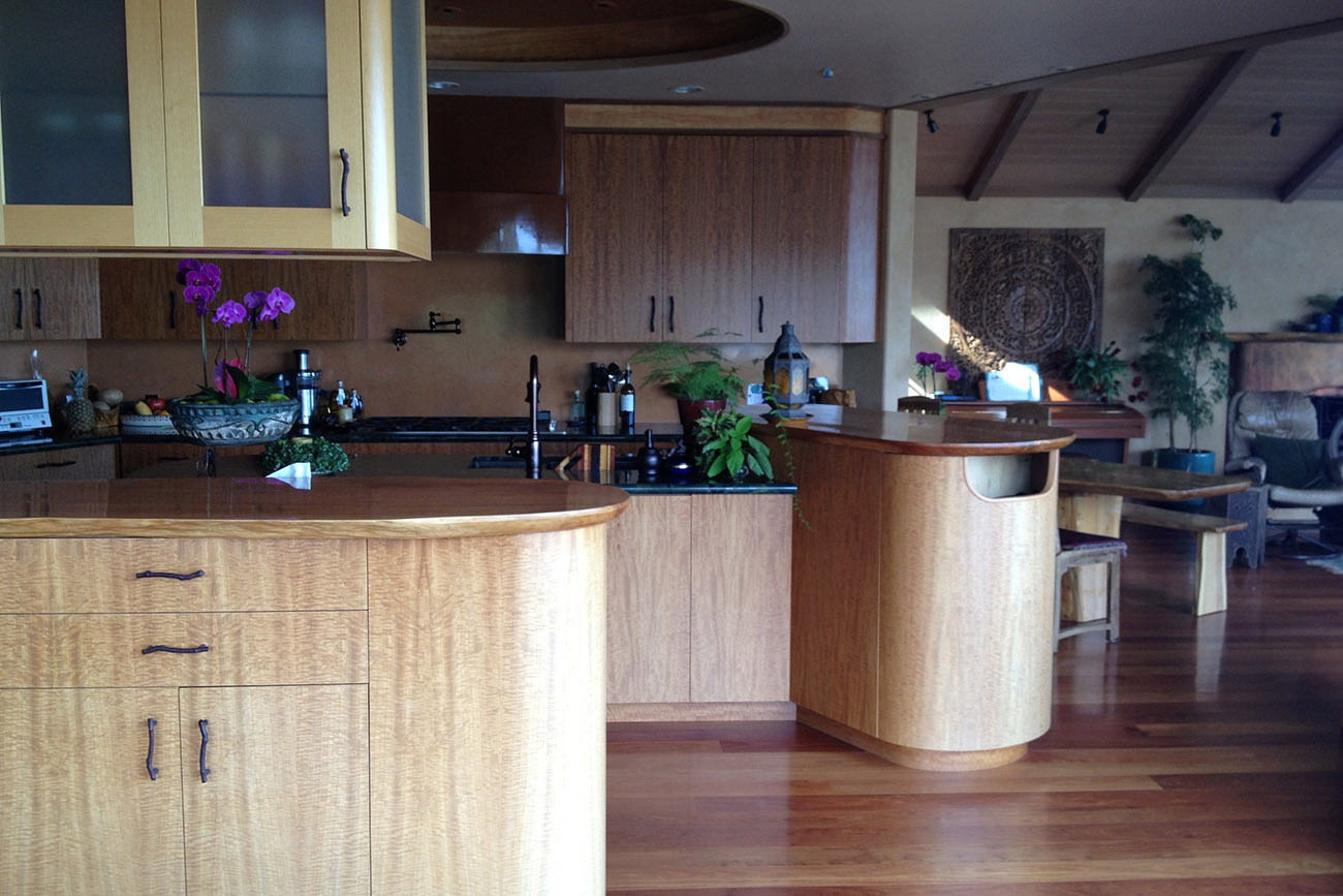 Custom Kitchen Cabinets. Red Gum wood with Cypress slab counters