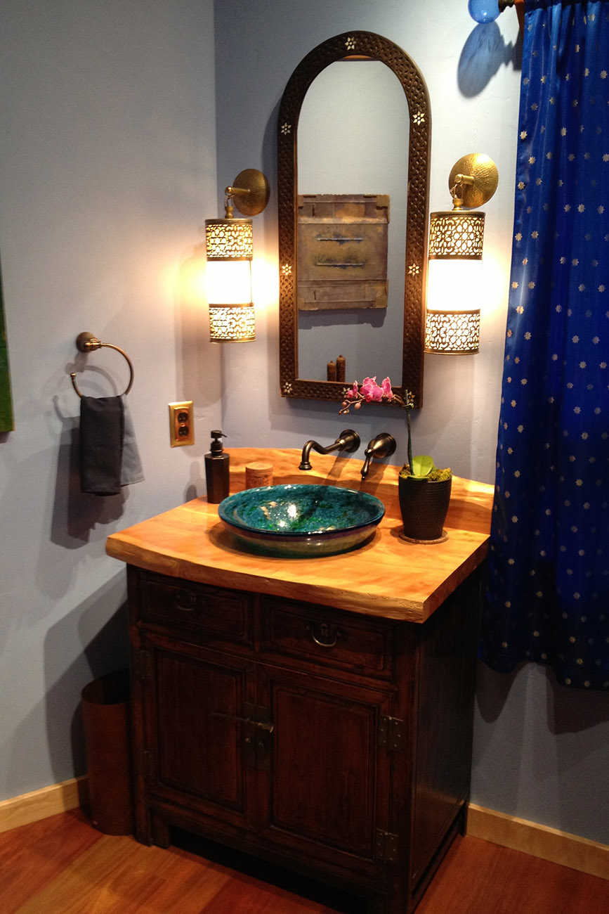 Custom modified vanity with Monterey Cypress slab top and glass bowl